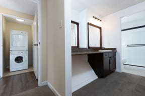 Hallway leading to washer/dryer closet and full bath