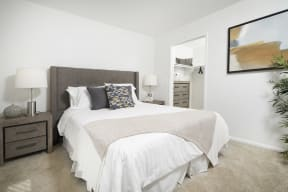 Apartments Thousand Oaks - The Knolls Spacious Bedroom with an Expansive Closet, Plush Carpeting, and Much More