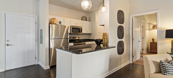 Ashland Farms Apartments Kitchen with Modern Lighting, Eat-in Counter, and Stainless Appliances