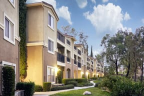 Escondido, CA Apartments - Exterior View of Alta Vista Apartments Building Surrounded By Lush Landscaping