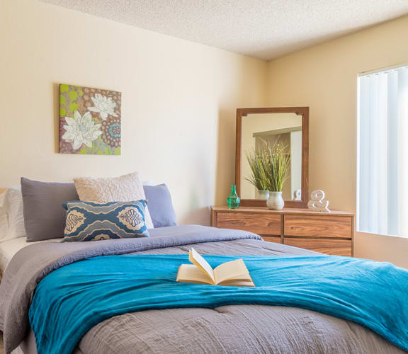 Sycamore Creek Spacious Bedroom with plenty of natural light, and drawers