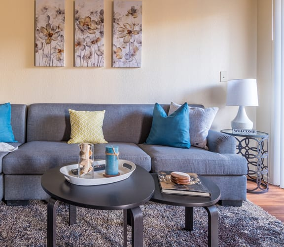 Enclave living room with cozy couches and wood flooring