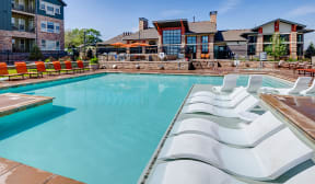 Pool with in water lounge chairs at Windsor at Pinehurst, Lakewood, Colorado