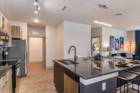 Spacious luxury kitchen with designer amenities in Coda Orlando apartment rentals in Orlando, FL
