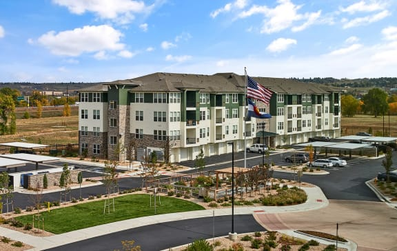 Enclave at Cherry Creek Apartments - Building exterior with ample parking
