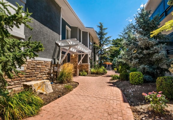 Path to the leasing office with beautiful landscaping
