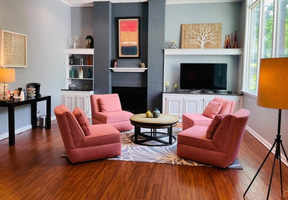 Model living area with fireplace at Tree Top Apartments in Raleigh, NC