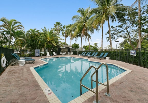 Outdoor Swimming pool at Brenton at Abbey Park Apartments in West Palm Beach FL