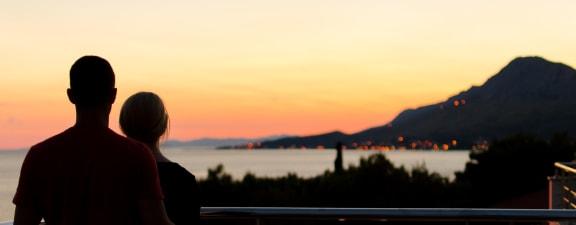 Couple in front of View at Canyon Villa Apartment Homes, Chula Vista, CA
