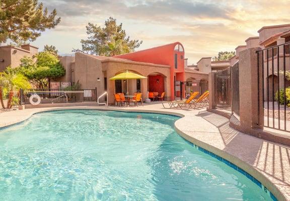 sparkling community pool and lounge deck at Glen Oaks Apartments, Glendale, AZ 85301