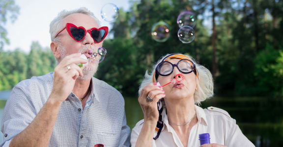 Seniors blowing bubbles | Vintage at Bellingham in Bellingham, WA