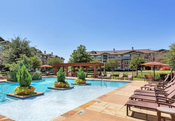 Pool with sundeck and chairs at Windsor Mustang Park, 4645 Plano Parkway, Carrollton