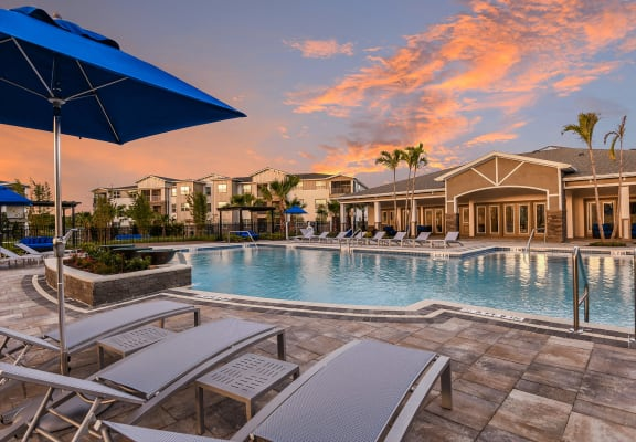 Sunset over the pool and lounge area at The Luminary at 95 West Melbourne, FL 32904