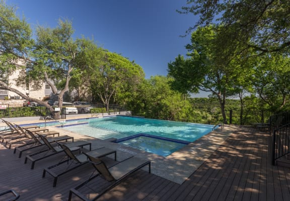 Retreat at Barton Creek Apartments Pool Area and Lounge Chairs