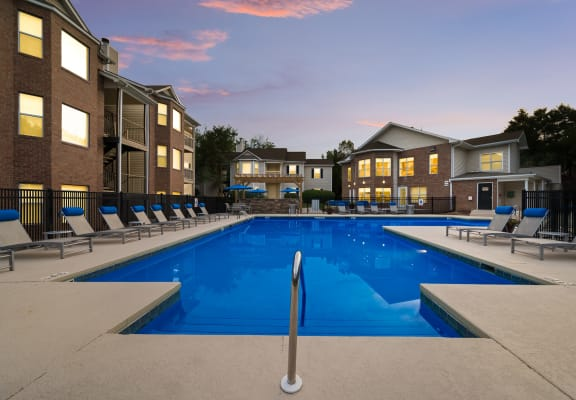 Chace Lake Villas resort-style swimming pool and back of the clubhouse at twilight