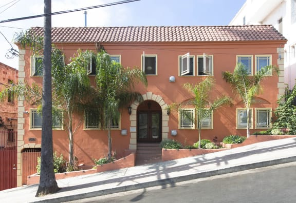 Los Angeles CA Apartments-Delta Apartments Exterior with Brightly Colored Exterior Paint, Windows that Open Outwards, and Lush Landscaping