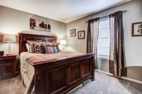 Master bedroom with carpet and lots of natural light