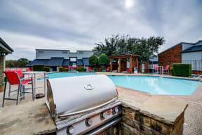 Relaxing swimming pool with cabanas and grill station
