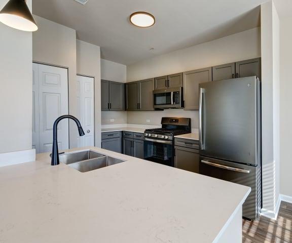 clean and modern kitchen at Farmington Lakes in Oswego, IL 60543