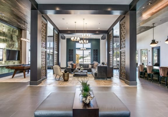Oro Stone Oak Apartments Clubhouse with Seating, Pool Table, and Bar Top