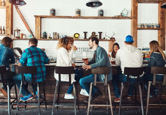 people conversing at bar at Liberty Mill Apartments in Germantown MD 20874