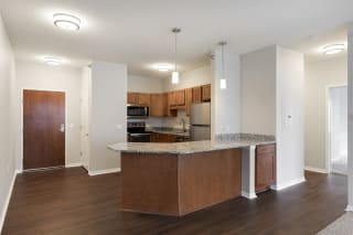 Kitchen Bar With Granite Counter Top at Waterstone Place, Minnetonka, MN, 55305