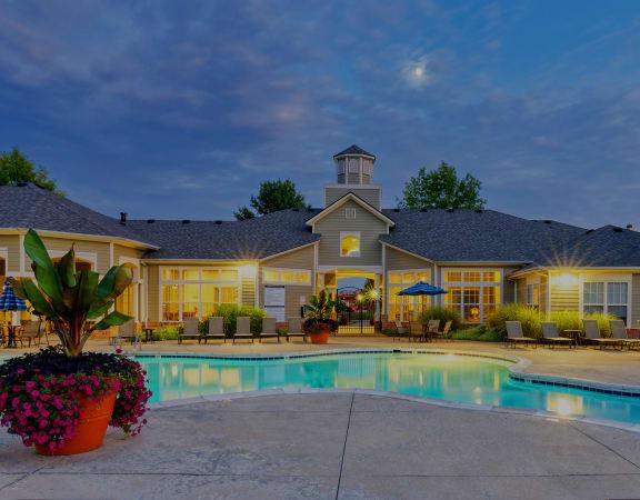 Lantern Woods Apartments - Resort-style pool at dusk