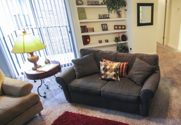 This is a photo of the living room in the 692 square foot 1 bedroom model apartment at Cambridge Court Apartments in Dallas, TX.