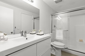 Hollywood CA Apartments for Rent - Cahuenga Heights Apartments Bathroom with a Large Vanity, Stainless Steel Fixtures, and Glass Shower