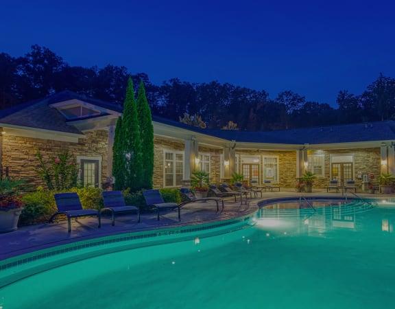 The Oaks at Johns Creek - Resort-style pool at dusk