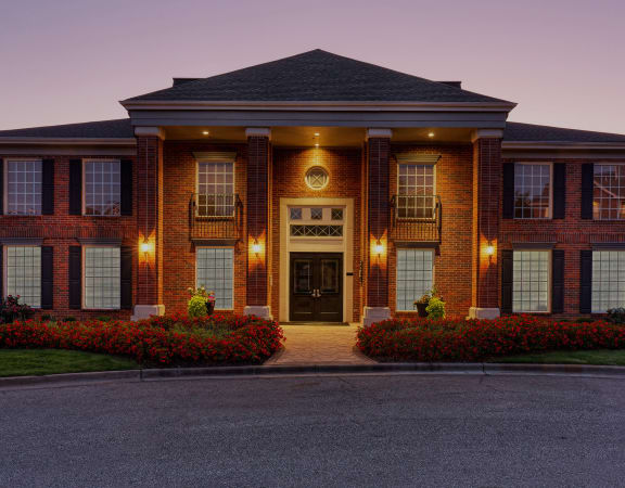 Weston Point Apartments clubhouse entrance with beautiful landscaping