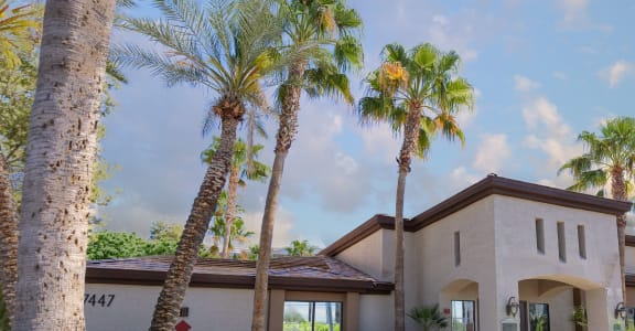 Exterior building & lush landscaping of Canyon Ridge Apartments in Surprise, AZ