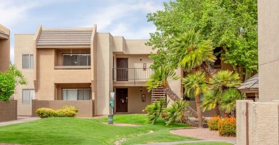 Exterior building & lush landscaping of Cimarron Place Apartments in Tucson, AZ 85712