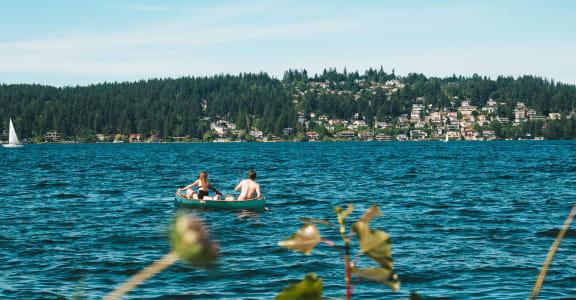 Residents Kayaking on nearby lake at Metropolitan Place Apartments in South Renton, WA