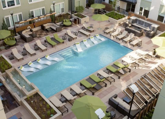 Swimming Pool with Lounge Chairs at ALARA Union Station Apartment Homes, 1975 19th Street Denver, CO