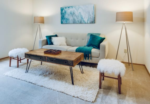 Tan couch with blue accents and table