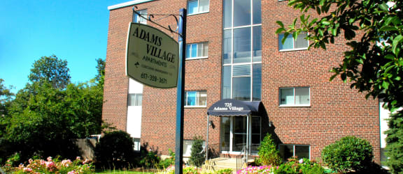 Adams village apartments sign and quality landscaping