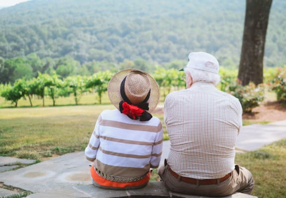 couple enjoying outdoors at reunion at redmond ridge- an active adult community