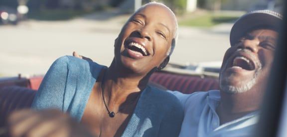 couple laughing at Terrace Gardens Apartment Homes, Escondido, California