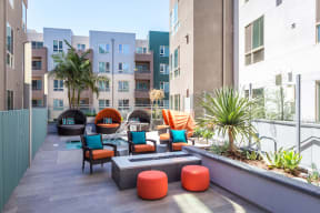 Los Angeles Apartments for Rent - Wakaba LA Outdoor Lounge with Chairs and Fireplace