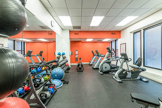 Fitness Center with weights and cardio equipment at Reside on Surf Apartments, Chicago, IL
