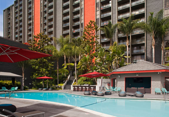 Apartments in San Diego CA - Resort Style Sparkling Pool at Lit on Cortez Hill Featuring Bar, Sundeck Lounge, and Various Pool Furniture