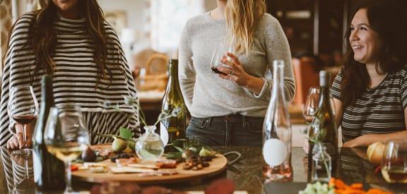 friends enjoying gourmet kitchen at Thorncroft Farms Apartments Hillsboro, OR