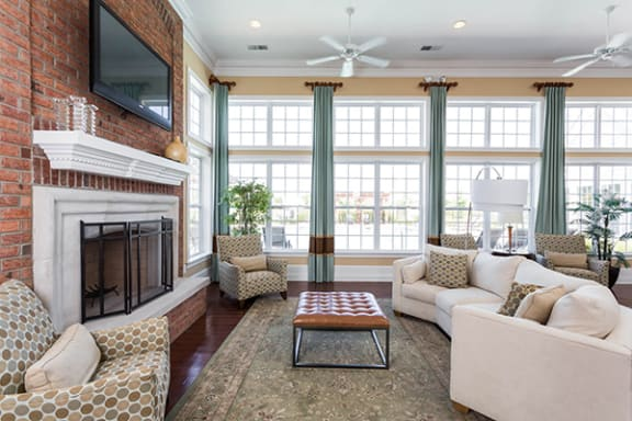 Comfortable Resident E-Lounge with Fireplace Seating at Brickshire Apartments, Indiana