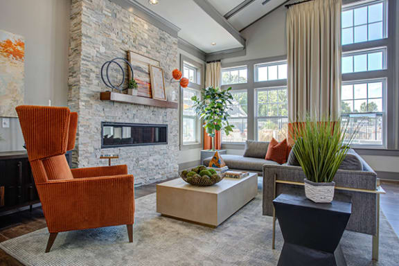 Elegant Clubhouse Fireplace Seating at River Crossing Apartments, Missouri 63303