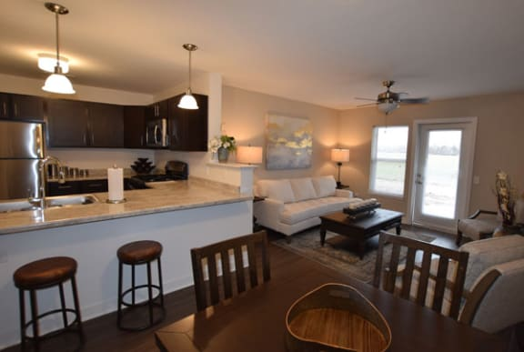 Kitchen with Breakfast Bar at Trade Winds Apartment Homes in Elkhorn, NE
