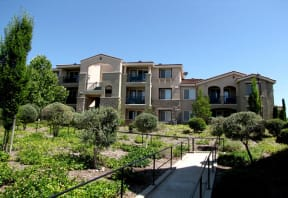 Roseville CA Apartments-The Phoenician Apartments With Lush Landscaping And Concrete Walkways With Railings