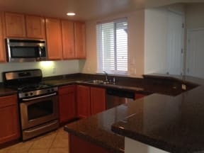 Apartments for Rent in Roseville-The Phoenician Apartments Kitchen With Breakfast Bar And Large Granite Counter Space
