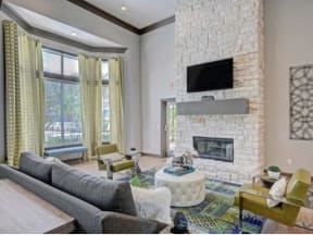 Clubroom area with TV, fireplace and ample soft seating.