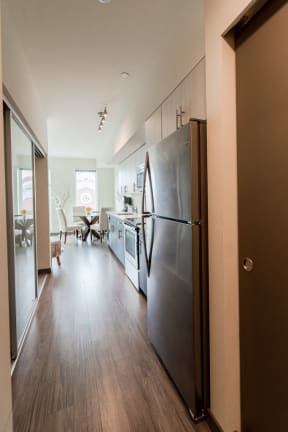 Seattle Apartments - Icon Apartments - Entryway, Kitchen, and Dining Room